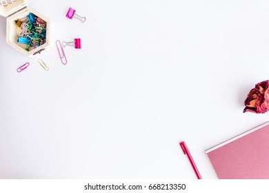 notebook paper, pencil, dry roses, sticky note, pine and paper clip on white background
