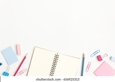 notebook paper, sticky note with pencil, paper clip on white background
