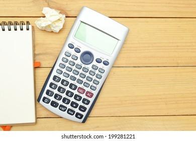 notebook, pen and calculator