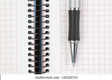 Notebook and pen closeup.