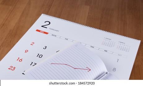 Notebook and pen on a calendar