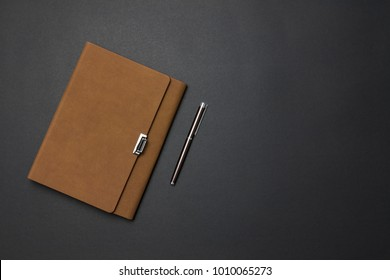 Notebook and pen on the desk
