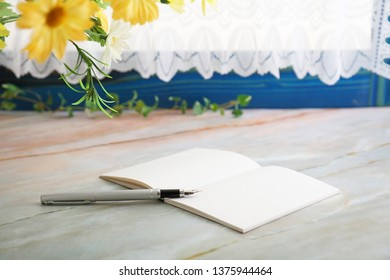 Notebook and pen on the desk.