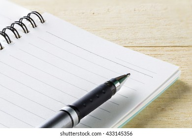 notebook and pen on table