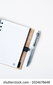 notebook and pen on white background, copy space