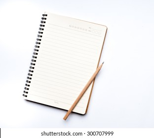 Notebook with a pencil
