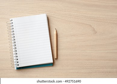 notebook and pencil on desk