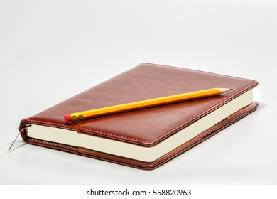 Notebook and pencil on the desk