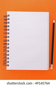Notebook with pencil on the yellow background