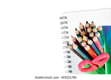 Notebook, pencils, scissors and ruler isolated on white background, photo