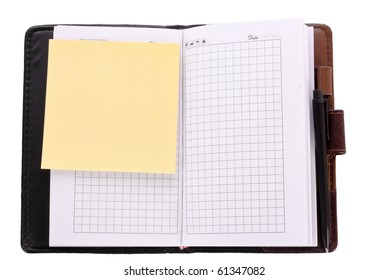 Notebook and reminder note isolated on white