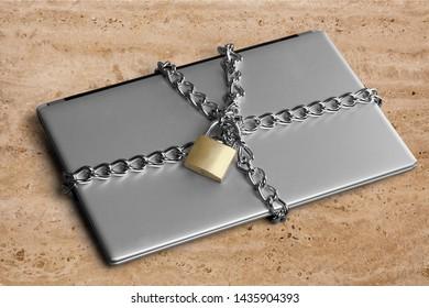 Notebook Security concept, laptop with a metal padlock