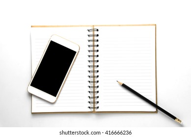 notebook with smart phone, cell phone on white table background. Top view