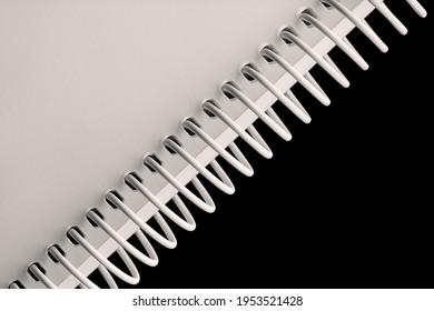 Notebook spiral spines on black background
