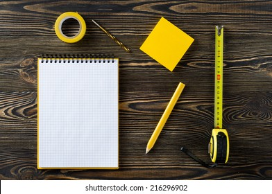 Notebook and technical tools on the table
