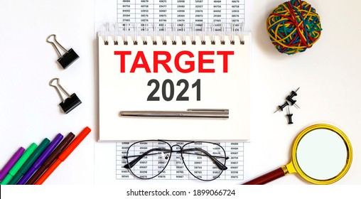 Notebook with text TARGET 2021 on table on chart
