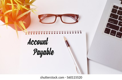 Notebook writing account payable,modern Office table with laptop