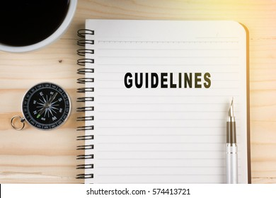 Notebook written with GUIDELINES word on wooden background. Business Concept.