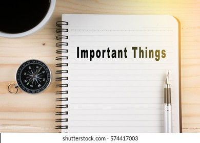 Notebook written with Important Things word on wooden background. Business Concept.