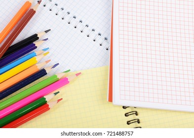 The notebooks and colored pencils. Business concept