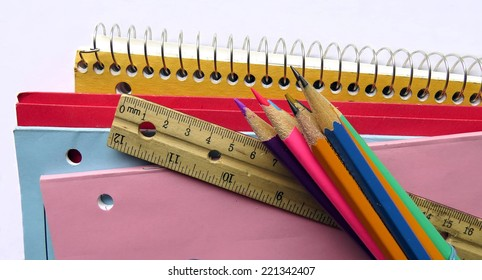 Notebooks, duotangs, exercise books, pencil crayons and ruler, school supplies