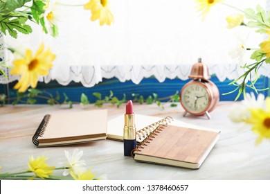 Notebooks on the desk.