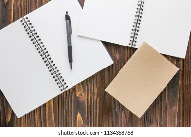 Notebooks and pen on wooden table ,Business Concept.