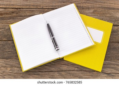 Notebooks with pencile  on wooden background