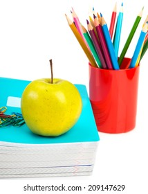 notebooks, pencils and apple. Back to school concept.