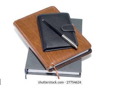 notebooks, wallet and pen isolated on a white background