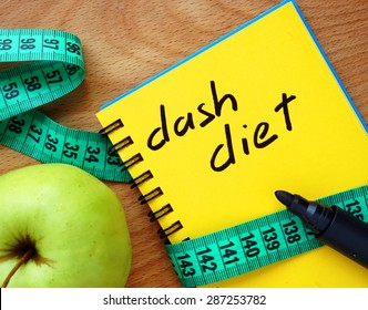 Notepad with dash diet, apple and measure tape