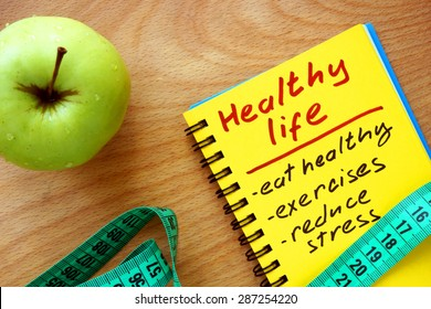 Notepad with healthy life guide, apple and measure tape