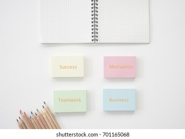 notepad with note book and pencil with business quote on white background