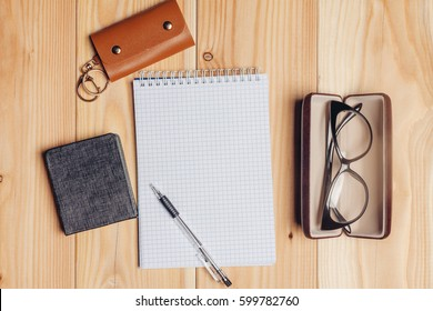 Notepad pen, glasses in a case, housekeeper leather