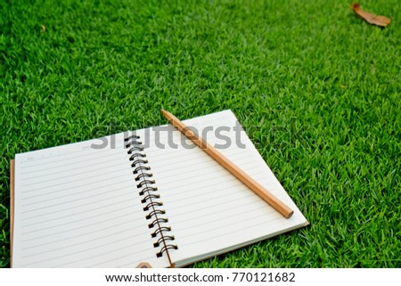 0f6728cf829 Notepad Pencil On Grass Background Blank Stockfoto (Jetzt bearbeiten ...