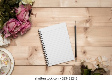 Notepad with pencil on the wood background, vintage style