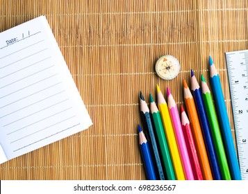 Notepad with pencil on wood board background. using wallpaper or background for education, business photo. Take note of the product for book with paper and concept or copy space.