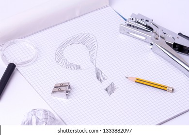 Notepad with a question mark drawn