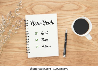 Notepad and text New year goal,plan,action with office accessories, Business resolution motivation and inspiration concepts.