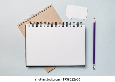 Notepad, white sticker and pensil on the desk. Mock up in copy space office background. It is important not to forget the note