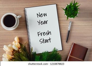 Notepad with wish list and coffee cup. New year's hope and resolution concept - New Year, Fresh Start.