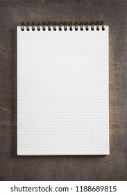 notepad at wooden background surface table, top view