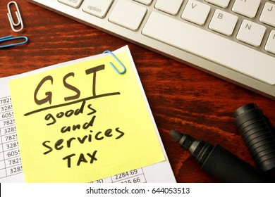 Notepad with word GST Goods and services tax.