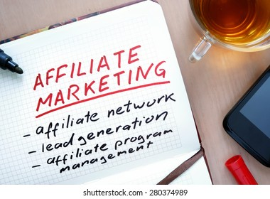 Notepad with words Affiliate marketing  concept and marker.