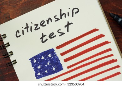 Notepad with words  citizenship test and American flag.