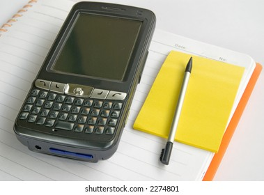 Notepad,memo and PDA on white background