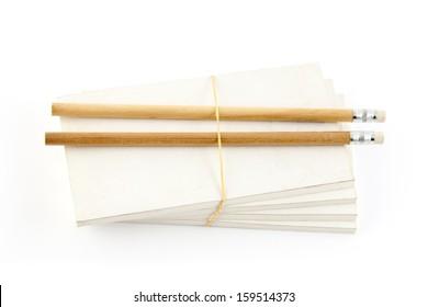 Notepads and pencils on white background