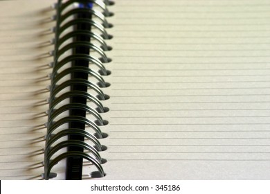 A notepaper spiral bound with visible lines, suitable to add own words.