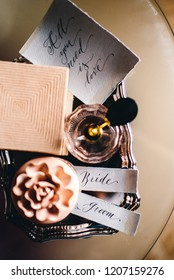 Notes with the inscription bride and groom are on the table with a wedding decor