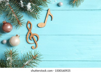 Notes on blue wooden background, flat lay with space for text. Christmas music concept
